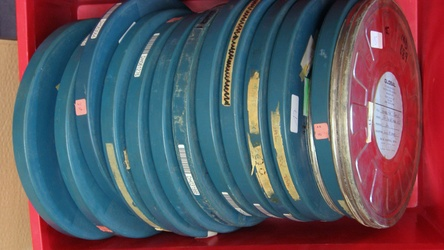 Pile of English 16mm positive film reels