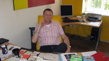 Karl Kolar in the office of moviemax GmbH movies & more
